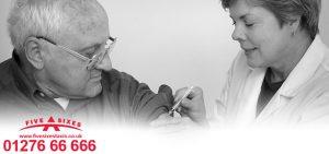 Senior male citizen having a vaccination by a female nurse